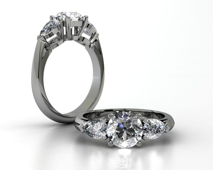 18ct White Gold 1ct Center & 2 .40cts Pear Shaped Diamonds Ring