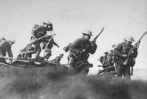 WWI Canadian troops (with fixed bayonets) photographed leaving their trench for a raid during the Battle of Somme
