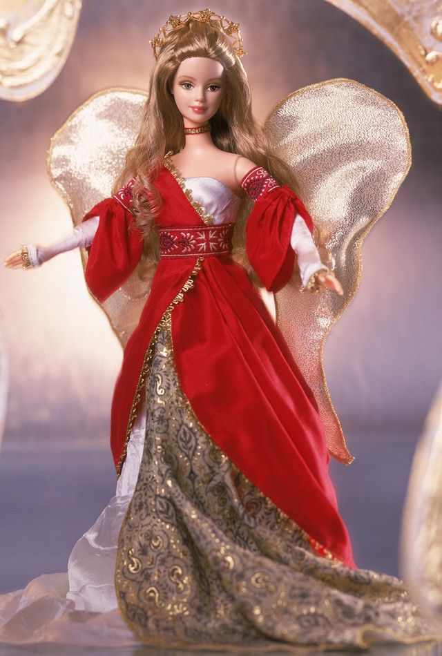 Holiday Angel Barbie® Doll #2 | Barbie Collector :: Second in the Holiday Angel series. Barbie® is a beautiful angel wearing a stunning ensemble inspired by the festive hues of the holiday season. Her red and golden gown is accented with a white bodice and sleeves and a distinctively textured white fabric that flows beneath the long red skirt. Completing Barbie® doll's ensemble are delicate golden wings, a ribbon choker and a shining golden halo. Release Date: 7/1/2001