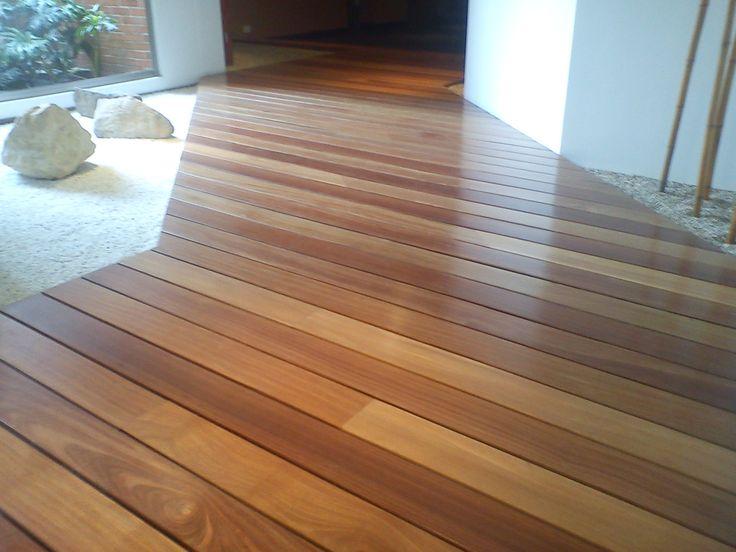 Madera maciza cumar deck interior for Puertas para pisos