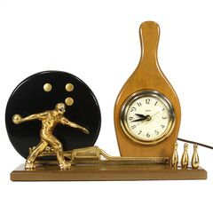 1950's bowling clock trophy in excellent working order. This beauty has been cleaned inside and out and keeps perfect time. Electric powered.