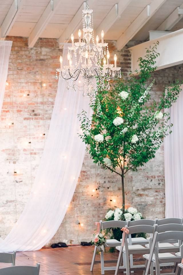 Edison wall of lights and the Luciana crystal chandelier at Bakery 105 - Created by High Performance Lighting