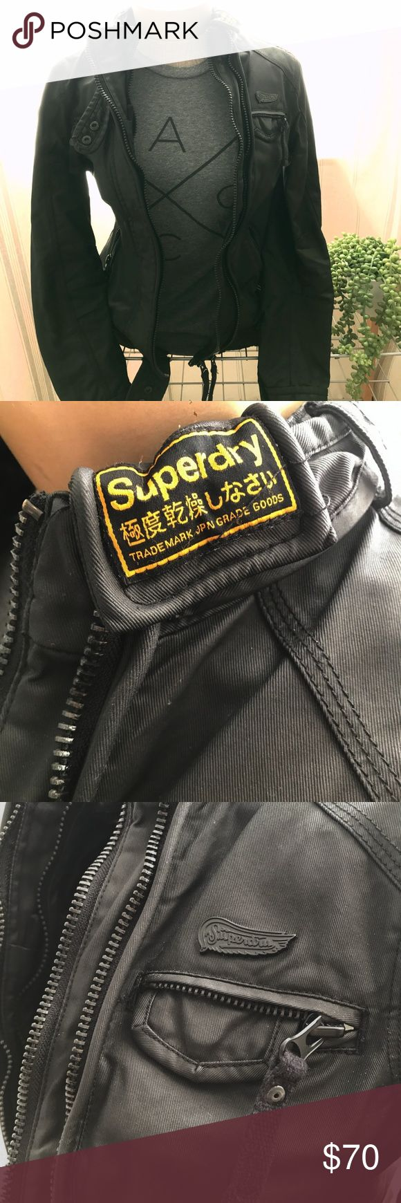 "*MOVING SALE* Superdry Black Motorcycle Jacket This is an authentic Superdry jacket in a black motorcycle design. The jacket is quite heavy but is 100% cotton for both the shell and interior. It has a ""waxed"" cotton look on the exterior. If you like pockets, you will love this piece - it has so many hidden compartments across the front and even in the sleeves! Only worn twice and in like-new condition. Superdry Jackets & Coats"
