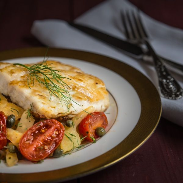 Pan-seared red snapper with fennel, grape tomatoes, and capers...an elegant meal to lighten things up during the holiday season