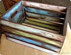 DIY:  How to Antique Wood with Paint and Stain - easy tutorial shows how to get this amazing finish by being a messy painter - by simply layering different colors of paint, then stain - via All Things Thrifty