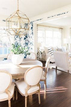 feminine dining room || floral wall paper || gold light fixture || louis chairs