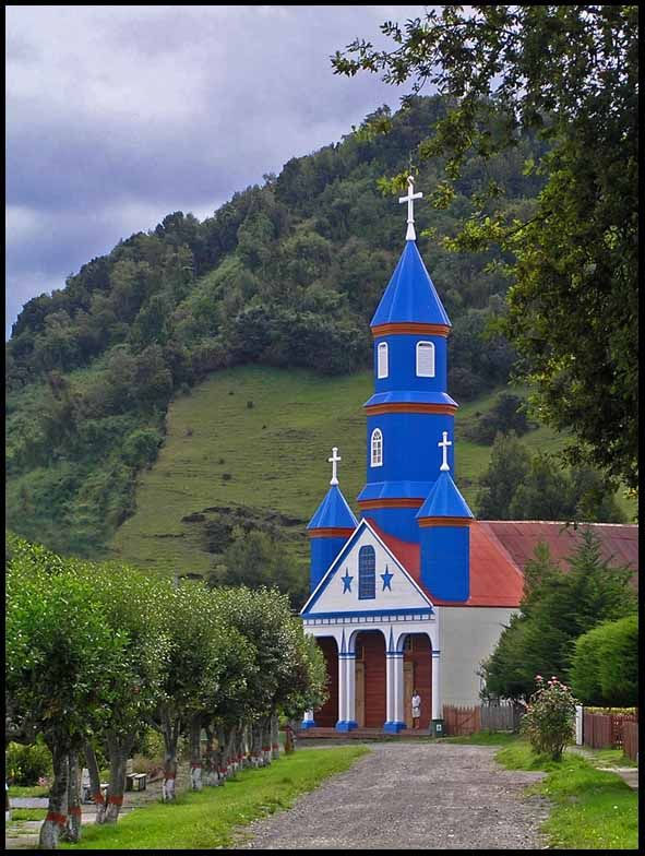 The Wooden Churches of Chiloe Island, Chile. Chiloé Island is the largest island of the Chiloé Archipelago off the coast of Chile, in the Pacific Ocean. The island is located in southern Chile, in the Los Lagos Region.                                  Photo by Gunga Jim Downs - Bing Images