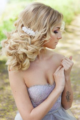curly low updo hairstyle for wedding and lavender wedding dress