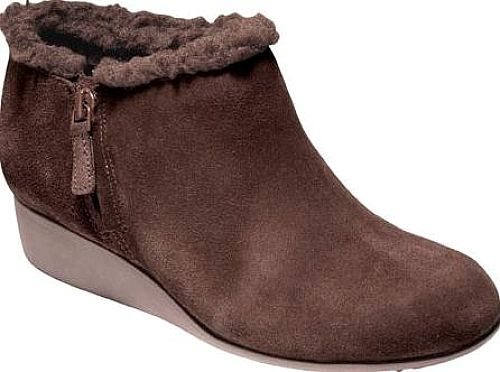 Cole Haan Women's Shoes in Chestnut Color. Stay dry with Callie Shearling Rain Shoe, featuring waterproof construction and a low wedge heel for a subtle lift. Waterproof upper with CH logo zip pull detail and faux shearling collar. Fully lined. Fully padded sock lining. Rubber wedge with traction and Grand. OS technology.