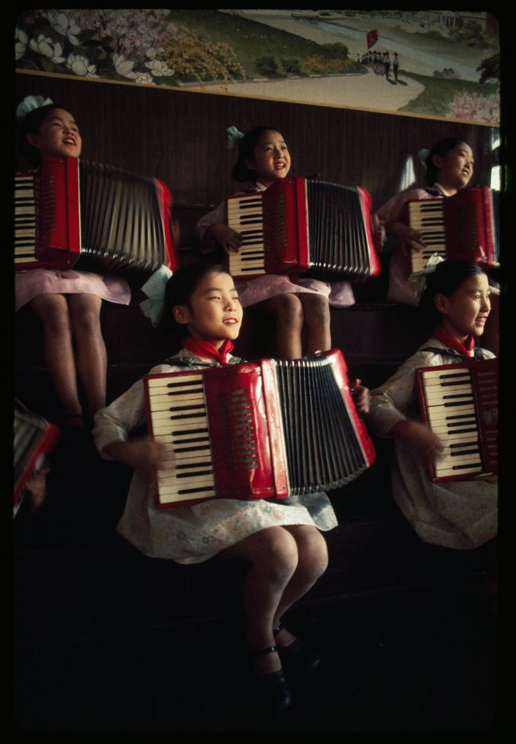 North Korean school girls practice playing accordions, August 1974.Photograph by H. Edward