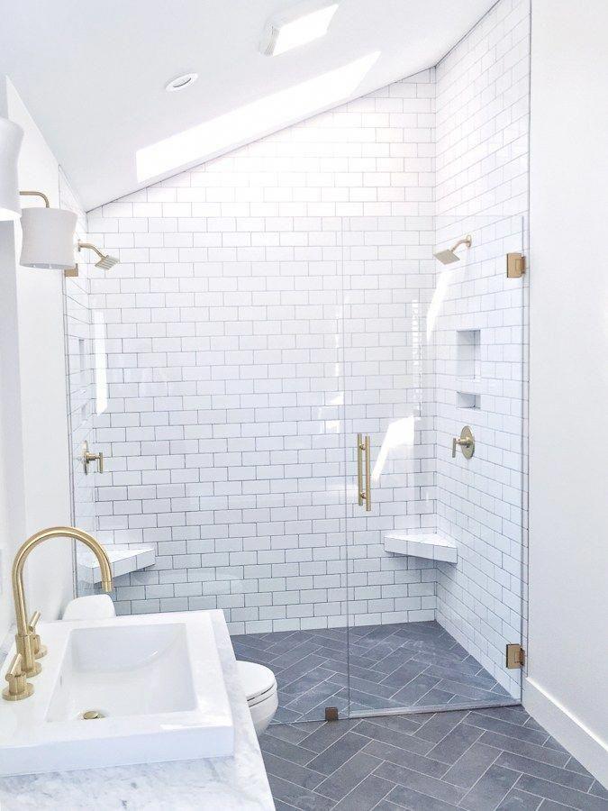 Master Bathroom With White Subway Tile Gray Herringbone Floors Brass Fixtures And Float White Bathroom Tiles Herringbone Tile Bathroom Bathroom Tile Designs