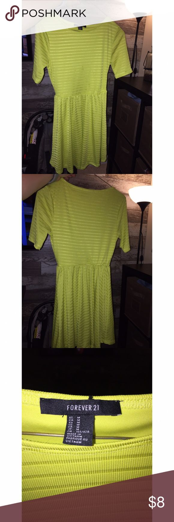 Neon yellow dress Neon yellow dress. Small stain not noticeable in person. The flash enhanced it ! Forever 21 Dresses