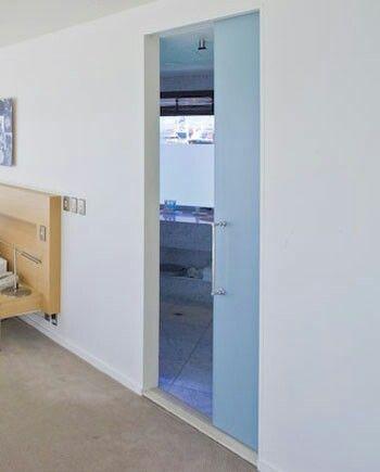 cavity sliders with frameless glass doors