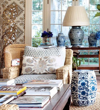 blue and white garden bench on porch at Tory Burch's house