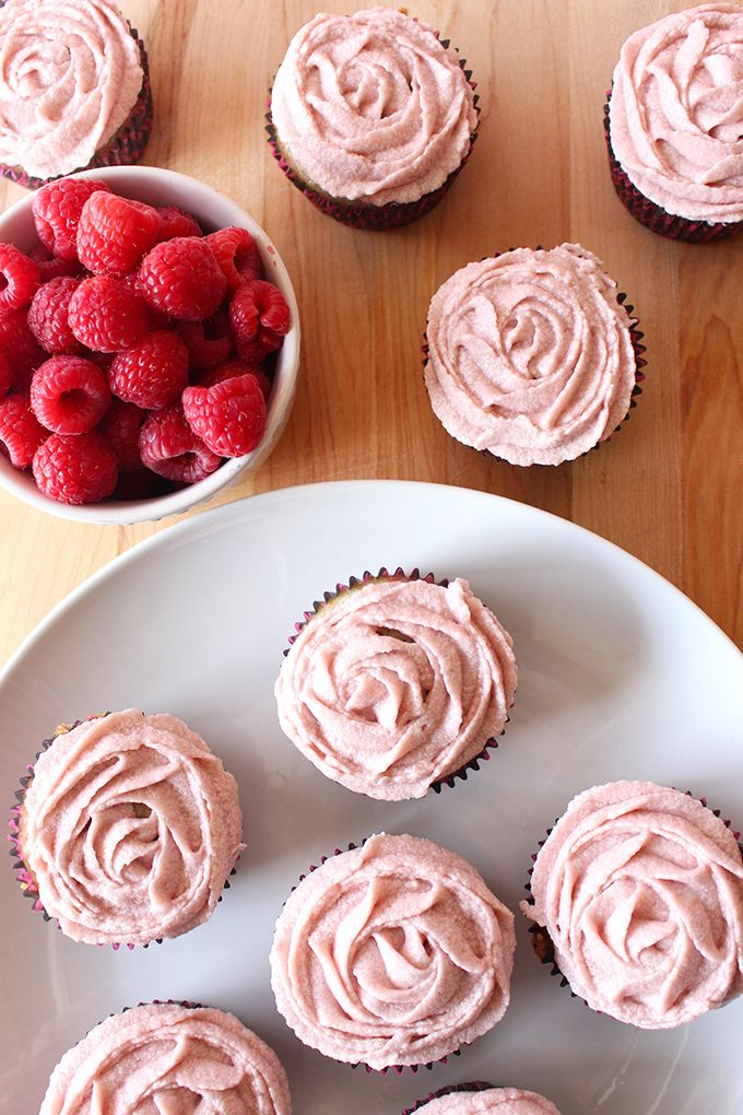 These vegan vanilla cupcakes are moist, light and delicious, and topped off with a simple but irresistible vegan raspberry buttercream!
