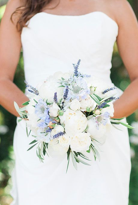 White Peony Bouquet with Blue Accents. A romantic bouquet comprised of white peonies, muscari, and greenery, created by The Monkey Flower Group.