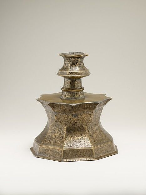Candlestick with Figural Imagery Object Name: Candlestick Date: first half 14th century Geography: Iran or Iraq Culture: Islamic Medium: Brass; cast, engraved, and inlaid with silver and black compound