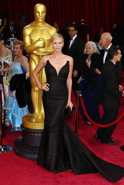 Charlize Theron selected a dramatic black Dior gown with sheer straps and a trumpet skirt.