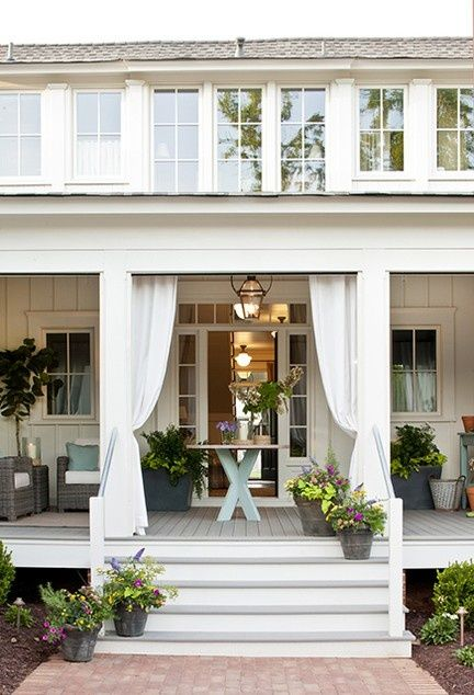 love this front door transom. The whole porch is lovely.