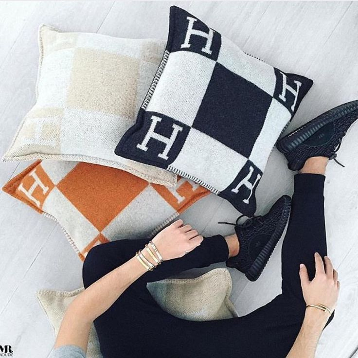 three beautiful HERMÈS Pillows.