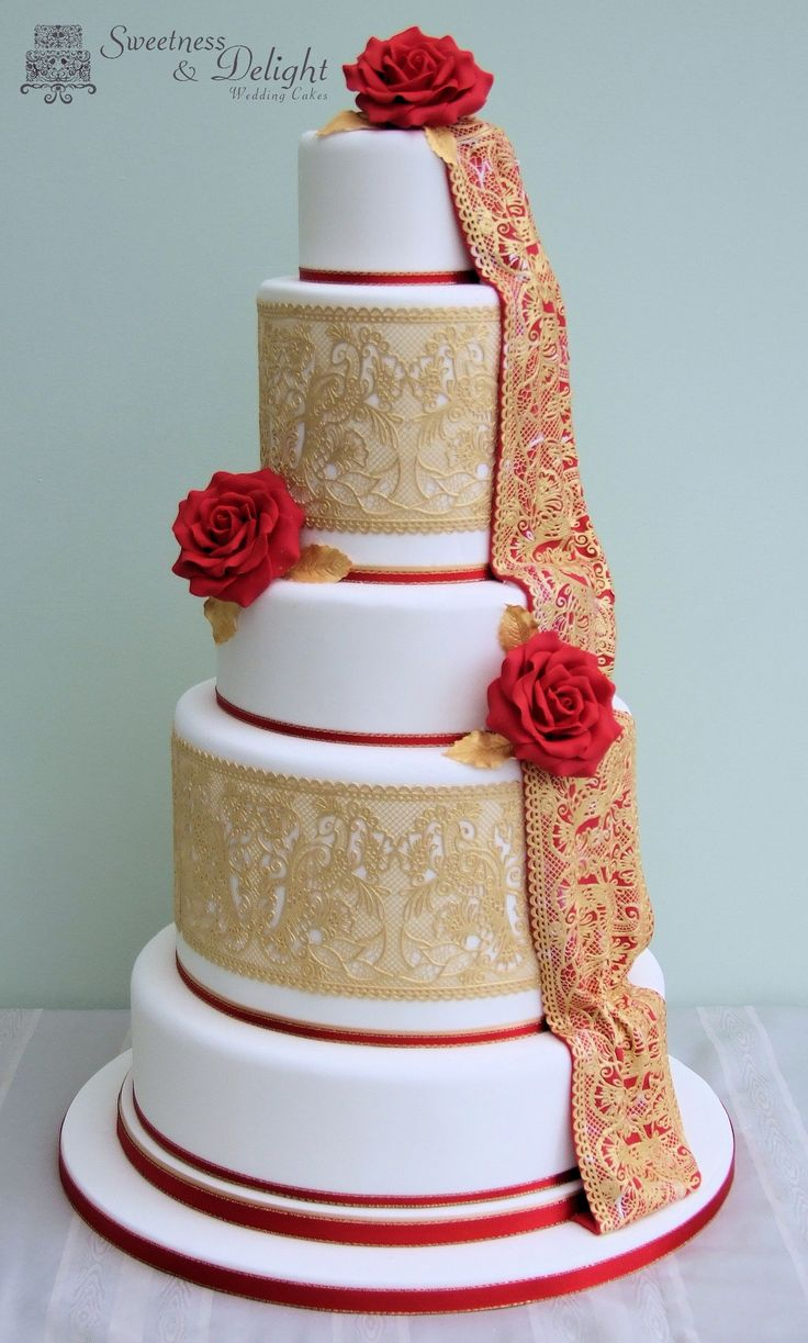Red & gold Asian Wedding Cake with peacock lace design and handmade sugar roses.