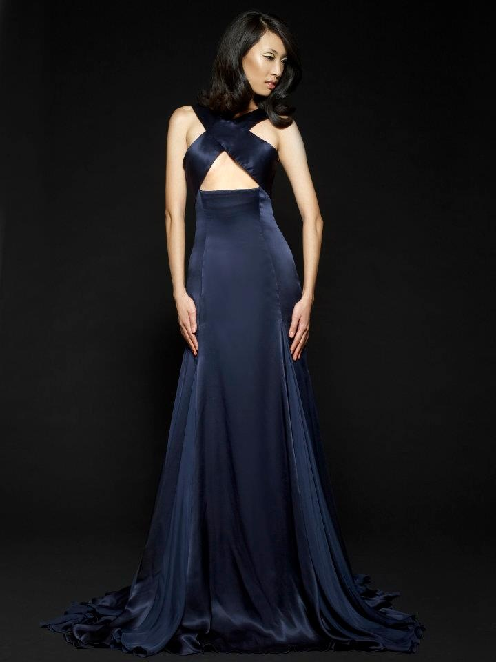 Beautiful midnight blue satin flowing gown with crossover bust straps that leave a flirtatious yet respectful cut-out.
