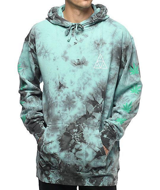 Show your cannabis spirit in the 420 Plantlife hoodie from HUF. A mint green tie dye, fleece lined hoodie features repeating mint weed leaves down each sleeve and white triple triangle at the left chest.