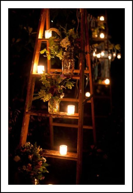 ladders with candles and flowers for ambiance.