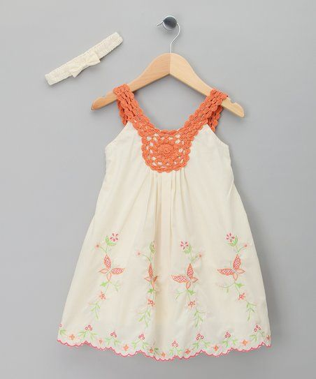 This darling dress combines oh-so-soft cotton with charming embroidery and a scalloped hem. Details like the crocheted straps and a matching headband make for one elegant yet effortless ensemble.
