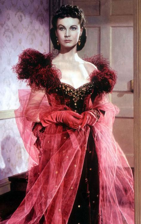 Scarlett's Shame ~ GONE WITH THE WIND.  Scarlett O'Hara looking positively wicked in this daring burgundy gown