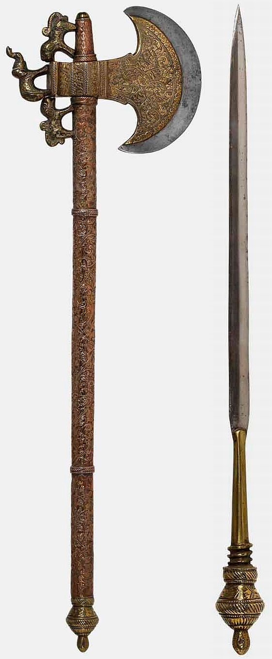 Northern Indian tabar (axe), 19th century, crescent shaped head with a brass covered steel blade decorated with engraved arabesque motifs The counter blade has an elephant surrounded by tigers made of forged brass. The handle is completely covered in brass, ornamented with a vegetal themed chisel work. It is finished by a lotus button which serves as a handle for a small dagger hidden inside it. Length: 56 cm; Axe's Blade Length: 13 cm; Dagger's Blade Length: 26 cm