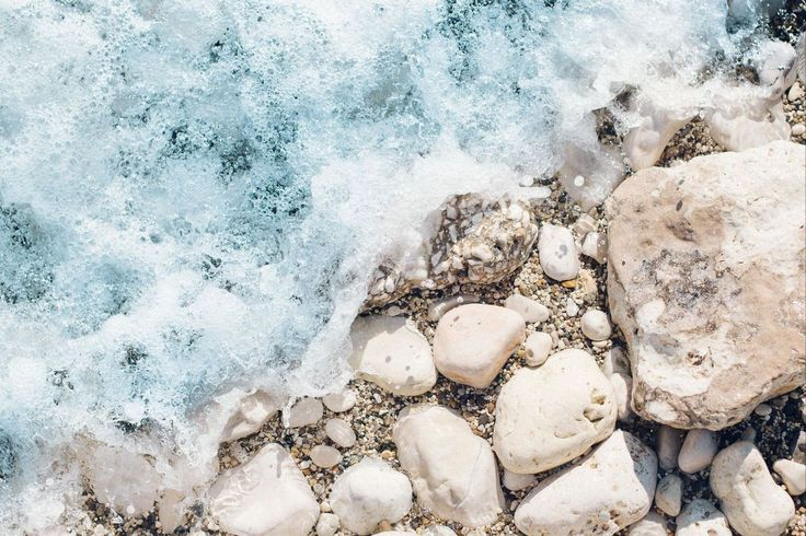 This beach wallpaper is for those who collect unusual rocks. Get some beautiful stones on your desktop, too.