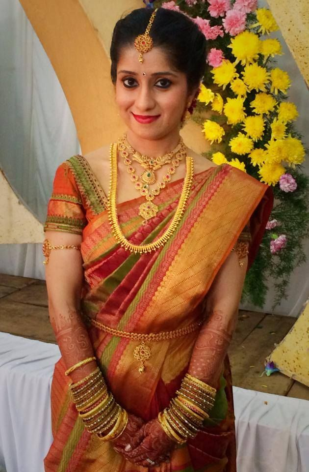 Traditional South Indian bride wearing bridal saree and jewellery. Reception look. Makeup by Swank Studio. Find us at https://www.facebook.com/SwankStudioBangalore