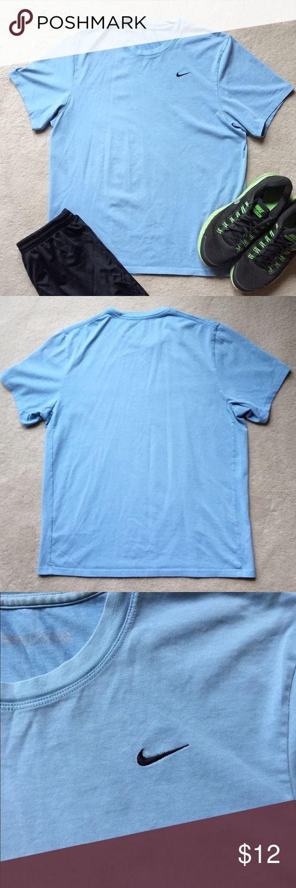 Nike Mens' Light Blue Shirt Versatile top for everyday. This Nike top is made of 60% cotton and 40% polyester. Nike Shirts Tees - Short Sleeve