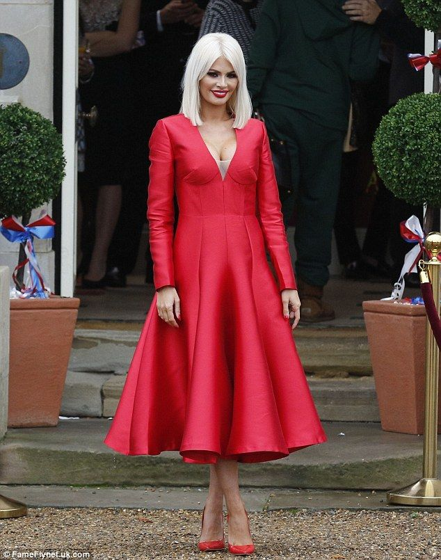 Bright move Chloe Sims oozed heaps of elegance in a striking silky red number, which boasted her plunging neckline and a pleated hemline
