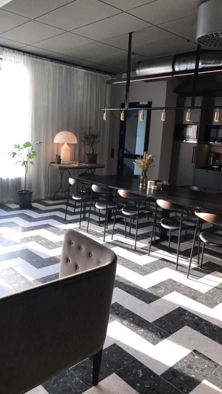 Terrazzo flooring, Carl Hansen chairs, Rubn light, &tradition sofa. Office space