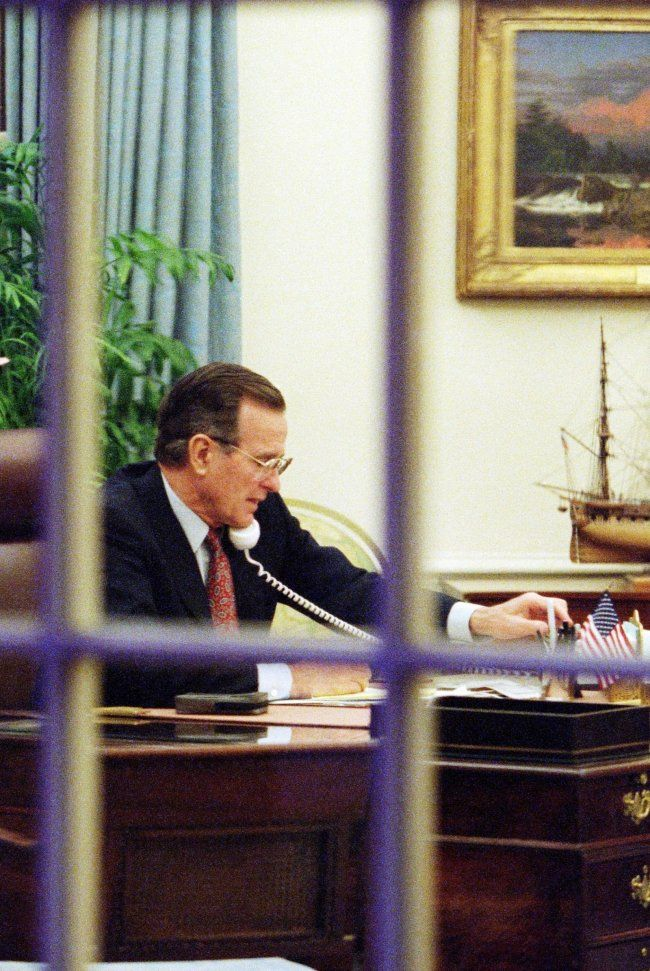 US president George Bush works in the White House Oval office in Washington on 17 January 1991 as Operation Desert Storm continues in an attempt by the US and its allies to force the Iraqis to leave Kuwait (J DAVID AKE/AFP/GETTY IMAGES)