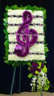 Custom Treble Clef Funeral Flowers, Sympathy Flowers, Funeral Flower Arrangements from San Francisco Funeral Flowers.com Search for sympathy and funeral flower arrangement ideas from our SanFranciscoFuneralFlowers.com website. Our funeral and sympathy arrangements include crosses, casket covers, hearts, wreaths on wood easels. Open 365 days and provide delivery everyday including Sunday delivery to funeral homes from San Francisco CA to San Mateo CA. San Francisco Flowers
