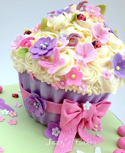 Giant red velvet cupcake, with pink and purple flowers