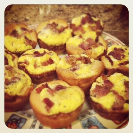 Bacon Egg and Cheese Biscuit Cups from Food.com: This is a recipe I found somewhere on the internet and have made some changes to suit the family's tastes. It is very simple and very good. I have used Grands biscuits before and just cut them in half before rolling them out.