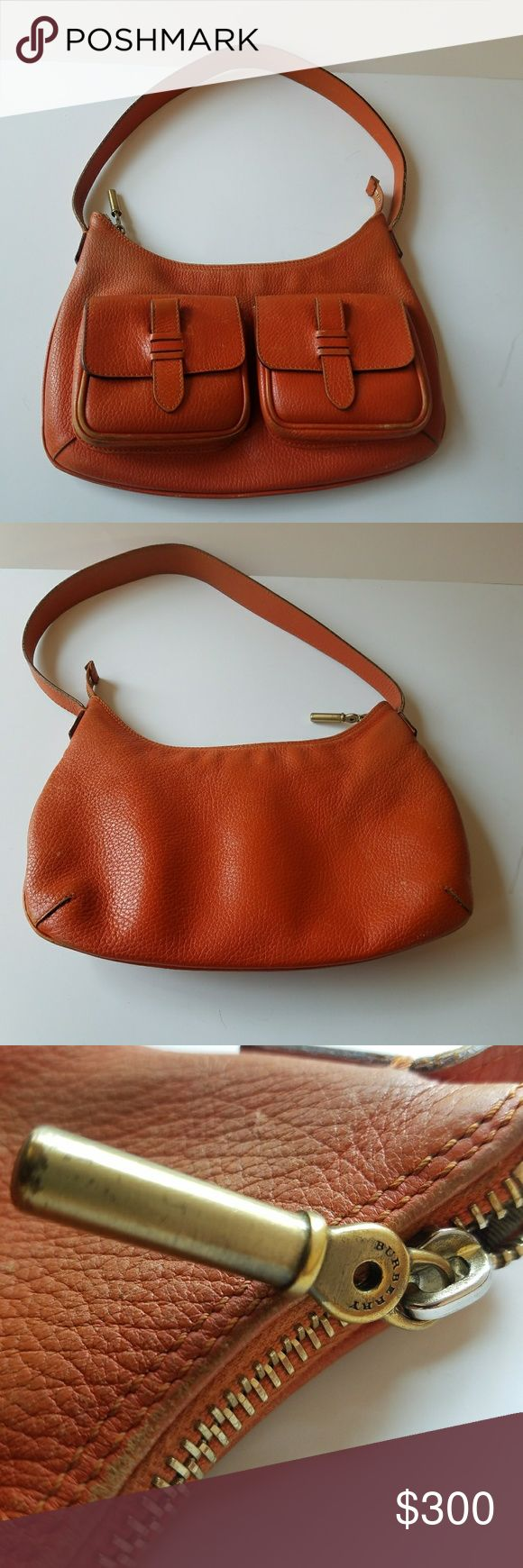 Burberry Orange Bag Here is your chance to own a Burberry Bag at an affordable price.  This bag is in good used condition.   See photos and zoom in.  It is beautiful and has lots of life left!!! :) Burberry Bags Hobos