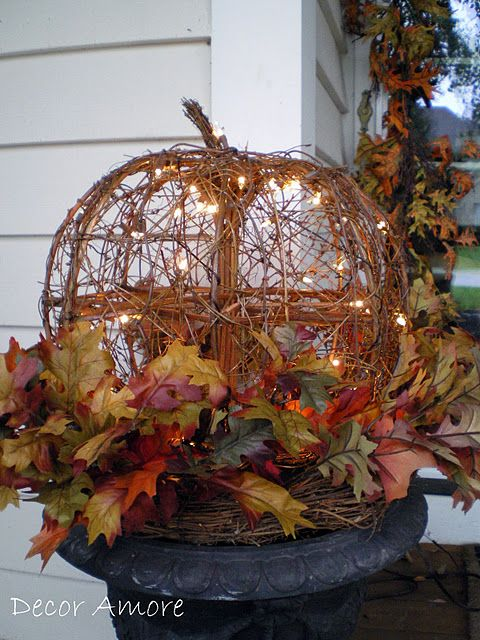 I have a similar pumpkin, the garland, and a black urn like this, I think I'll do this on the front porch this year with the twinkle lights. Cute and will last Oct. 1st through Thanskgiving.