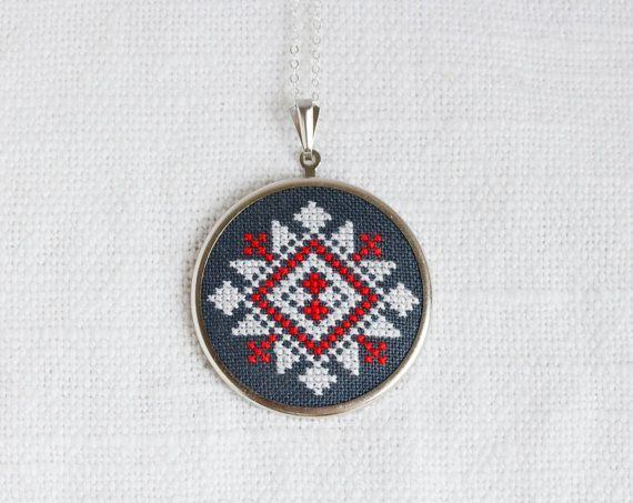 This necklace is inspired by traditional Slavic embroidery. It was embroidered on hand dyed linen fabric dark grey color by cotton embroidery floss.