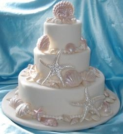 Fondant Shell Wedding Cake With Pink Accents
