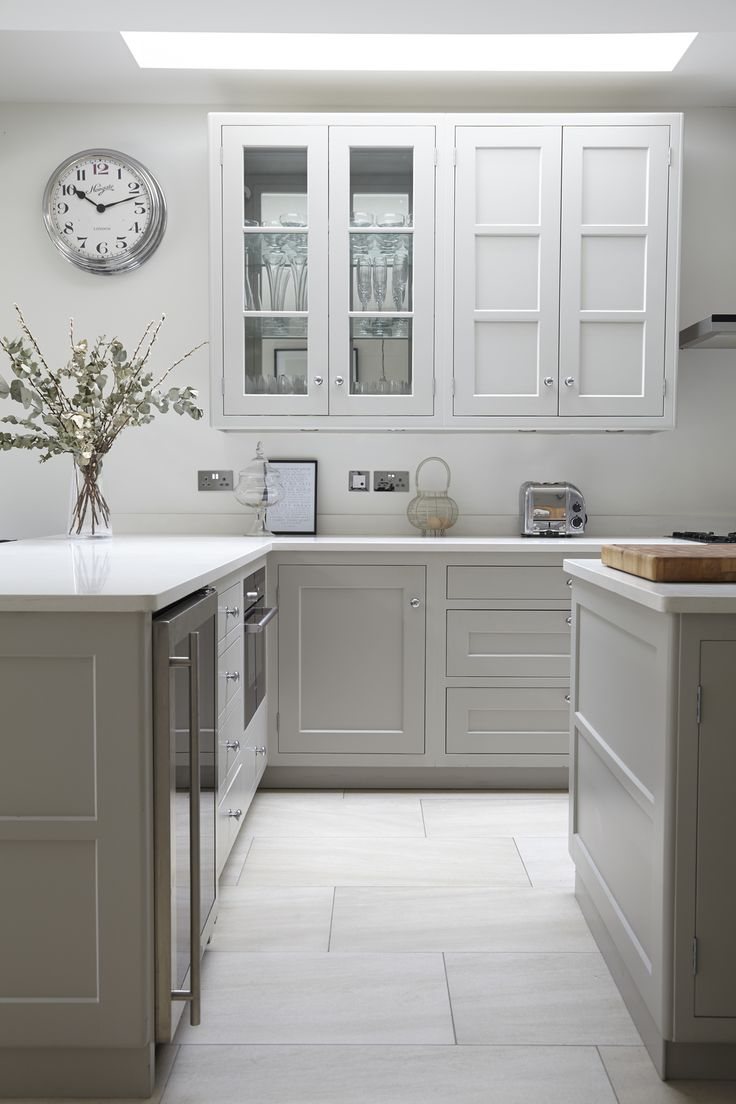Farrow & Ball Pavilion Grey shaker style kitchen and mirrored backs to the glazed cabinets
