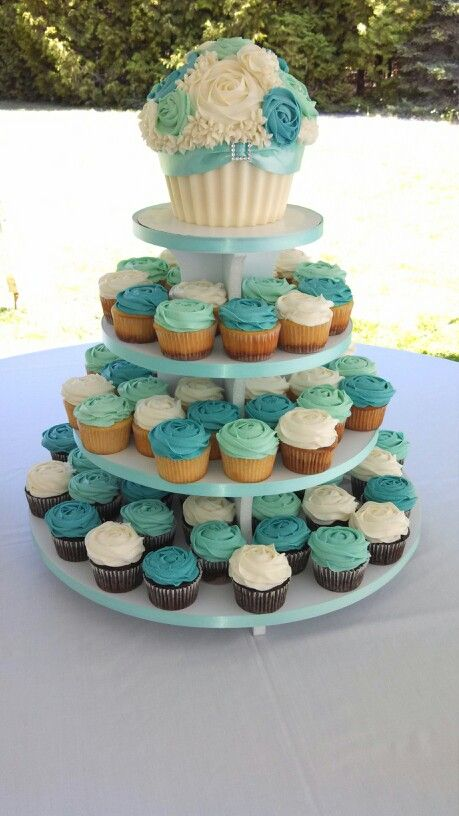 Wedding cupcake tower with Bride and Groom Giant Cupcake. Teal & White. @saralcollins44