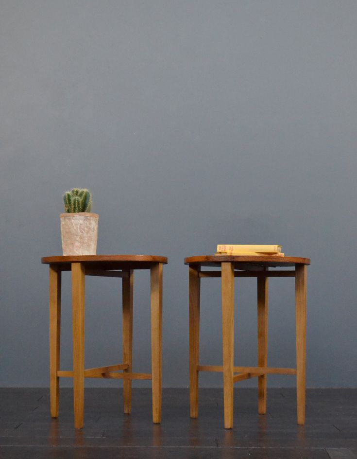 Pair of mid century teak folding tables / bedside tables. Constructed of real teak wood with folding leaves for easy storage when not in use. A great minimalist design, these tables would suit both vintage and contemporary interiors.