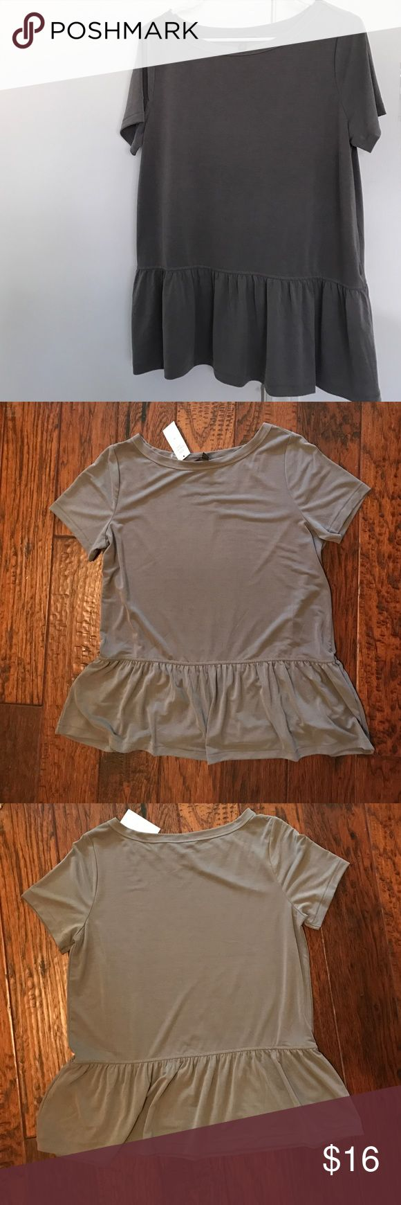 Banana Republic gray peplum shirt New, never worn peplum top. This shirt is a slightly heavier weight compared to a regular tshirt. 78% modal 22% polyester Banana Republic Tops Tees - Short Sleeve