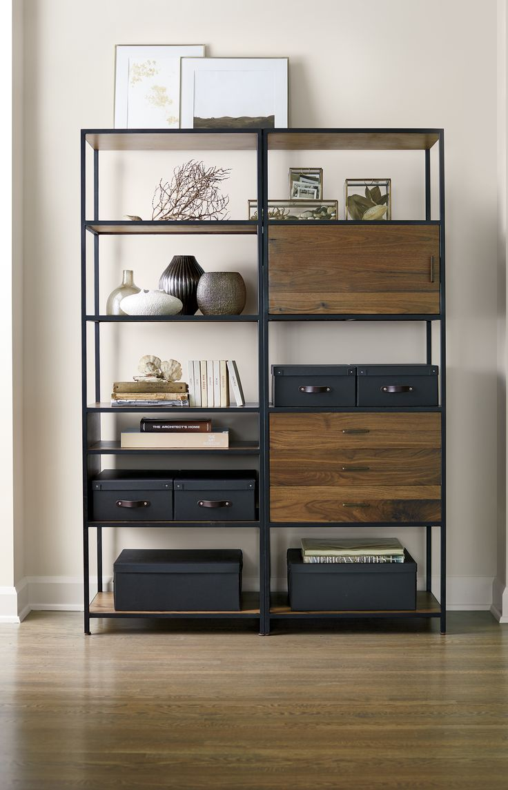 Doors, shelves and drawers of solid walnut are set within slim, architectural iron frames in the clean-lined Knox collection. The versatile mix of open and closed storage provides a versatile design that works well in any room.