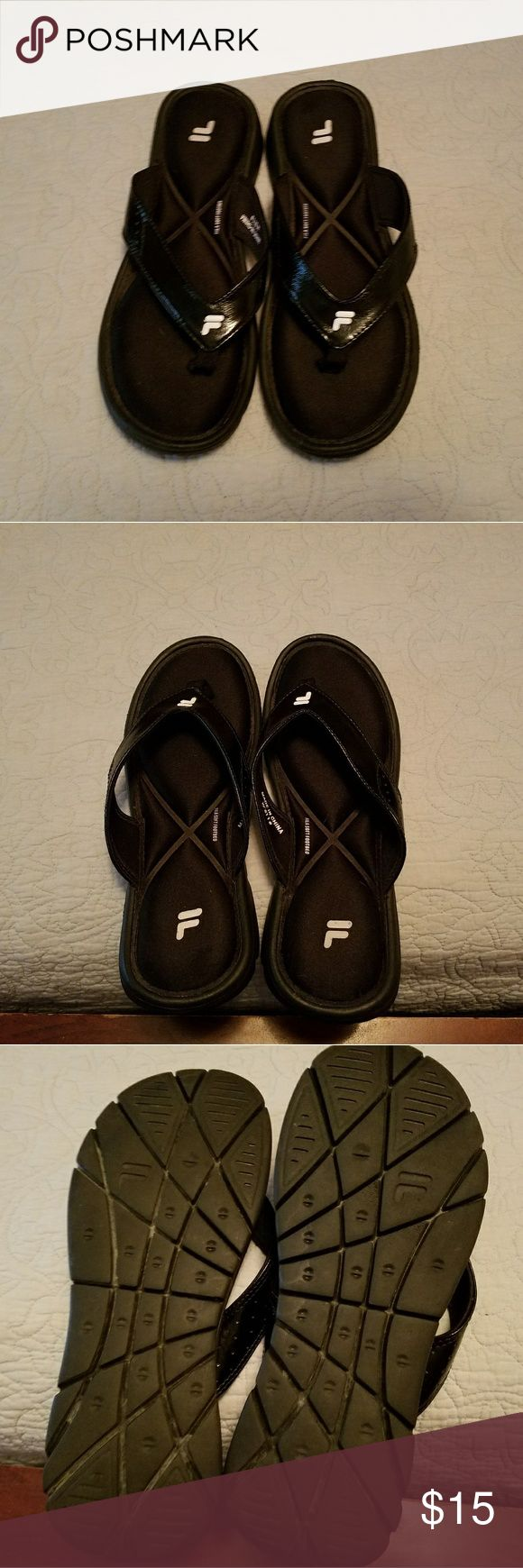 Women's size 11 Fila flip flops Women's black Fila flip flops with cushioned footbed. Excellent condition. Fila Shoes Sandals